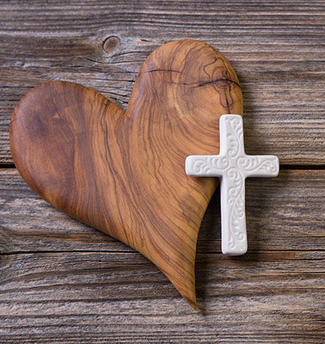 Cross Next to Wooden Heart